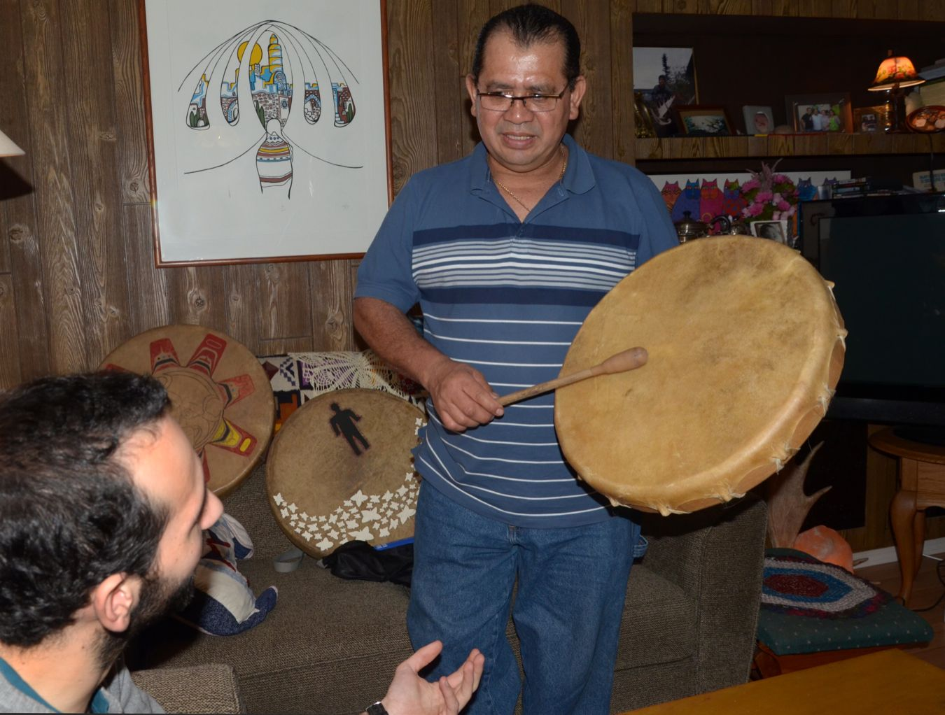 Julio Amaya explains the significance of drumming to Sebastian