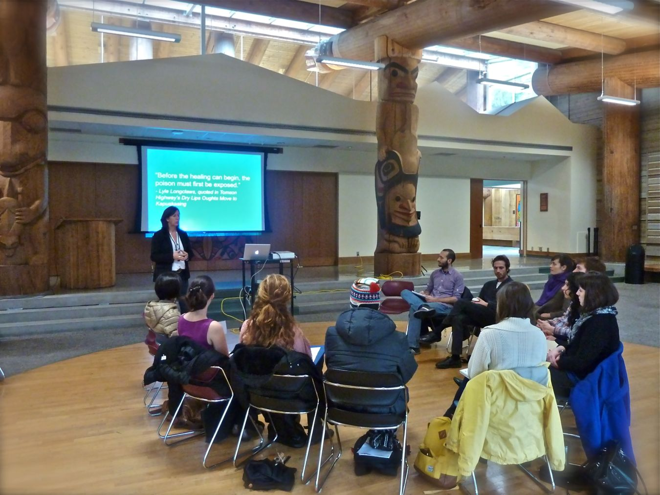 Debra Martel explains house posts at First Nations House of Learning