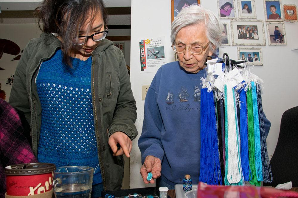 Gen Cruz checks out an elder's craftwork in Squamish