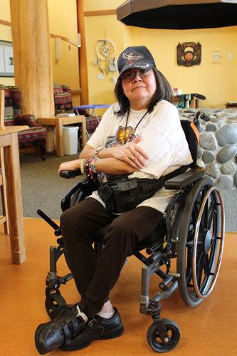 Bernice Williams sitting in the Sto:lo Elders Lodge common area.