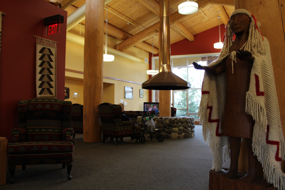Timber house posts frame the common sitting area of the Sto:lo Elders Lodge.
