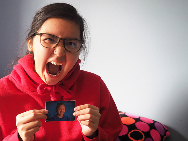 Hailee Leon is now 16. She holds a photo of herself from the first year she went to puberty camp. Photo by Stefan Labbe.