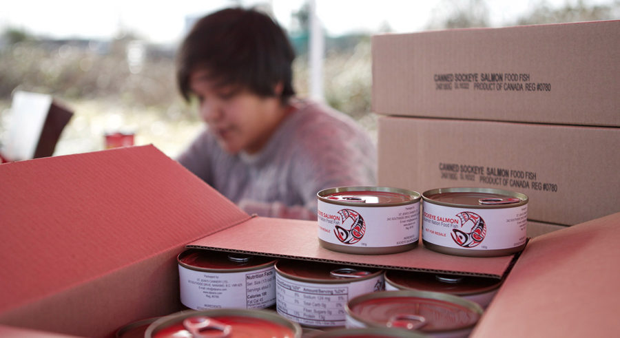 Squamish Nation's first-ever commercially canned salmon is distributed to the community in front of St. Paul's Church on Mission reserve.